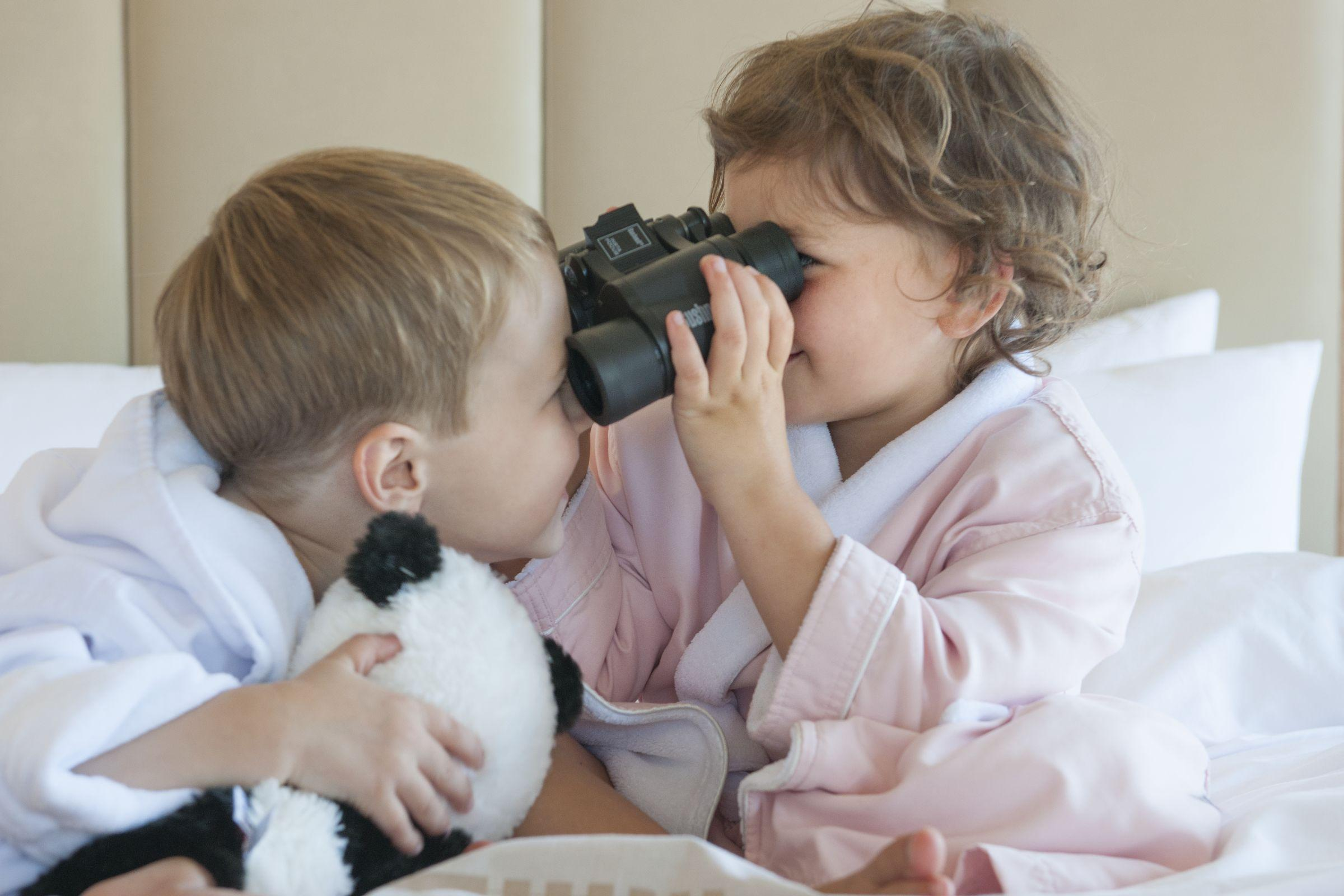 Kids enjoying the binoculars offered in every room