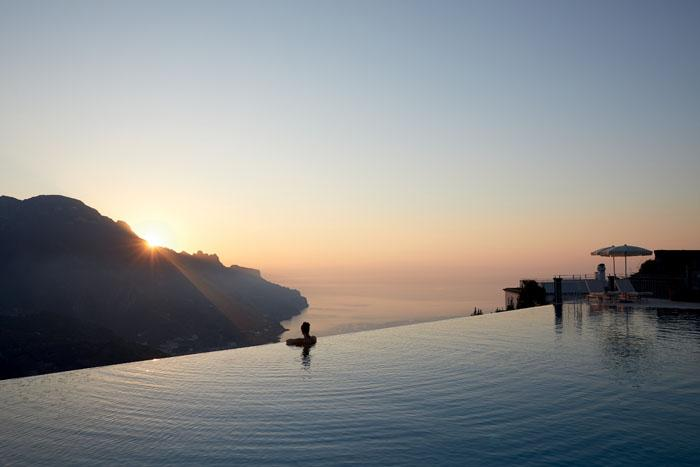 Infinity pool suspended between sea and sky
