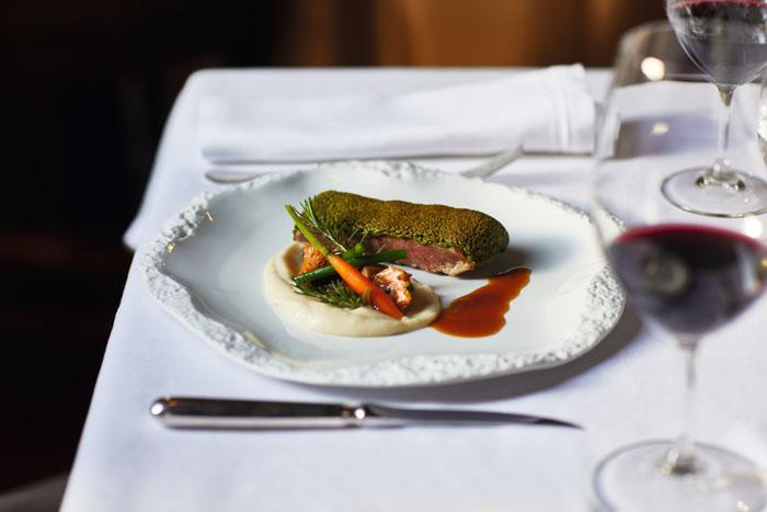 Mallorcan lamb loin in a crust of herbs served with celery puree and rosemary sauce